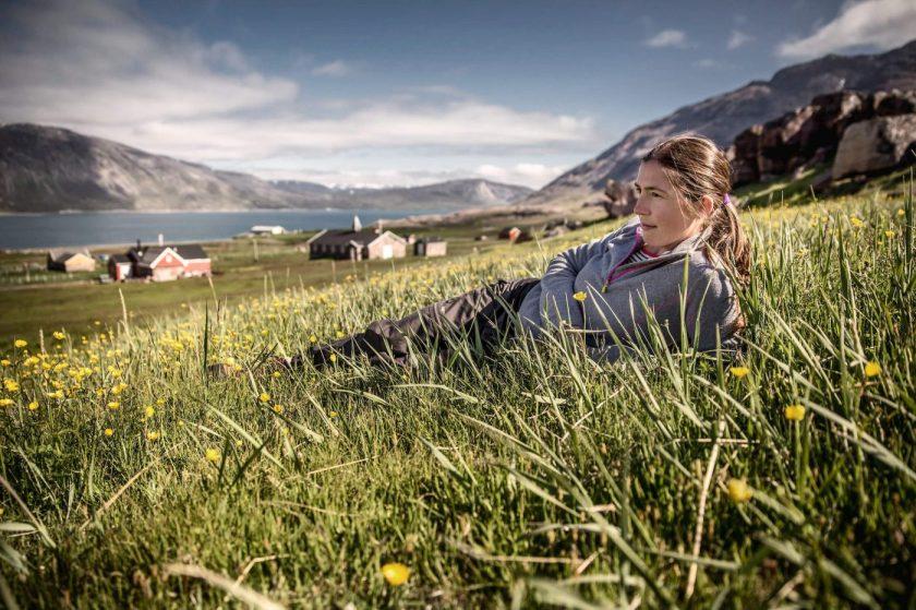 n a-traveler-enjoying-the-summer-sun-in-igaliku-in-south-greenland-1-1400x933