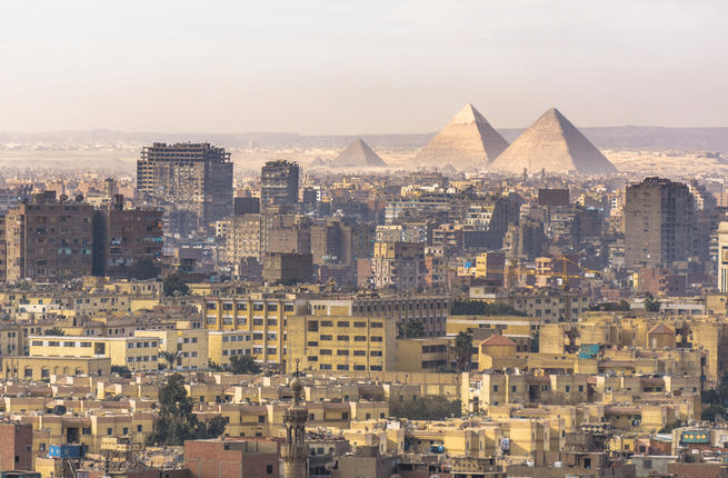 Landscape-of-Cairo-Egypt-pyramids-on-the-background-drowning-in-waste-WOIMA-Corporation
