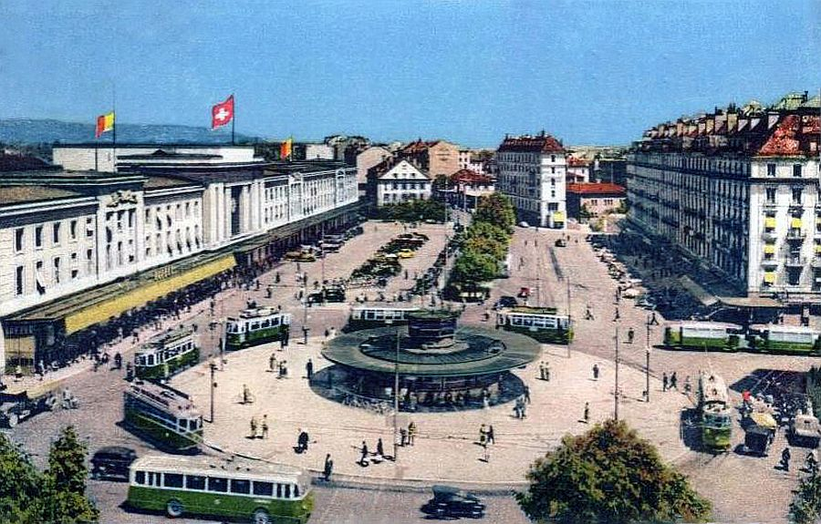 transpress nz: trams and buses outside Geneva Station, Switzerland, 1950s